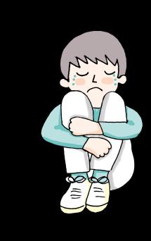 Niño agazapado llorando